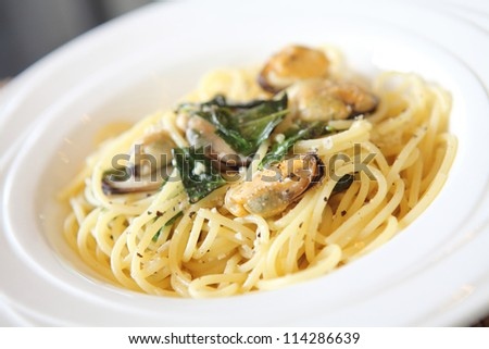 Spaghetti with mussel and olive oil - stock photo