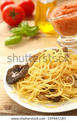 Spaghetti with oyster mushrooms in white plate