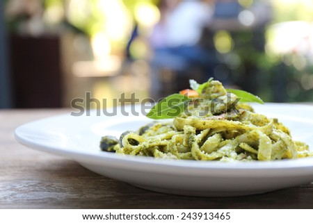 spaghetti with pesto sauce - stock photo