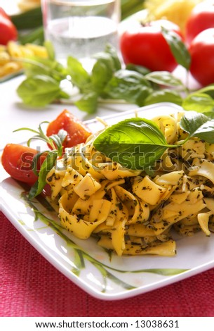 Spaghetti with pesto sauce and cheese - stock photo