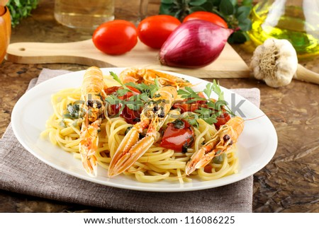 Spaghetti with prawns on complex background