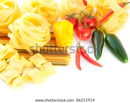 Spaghetti with red pepper, a basil and a tomato on a white background - stock photo
