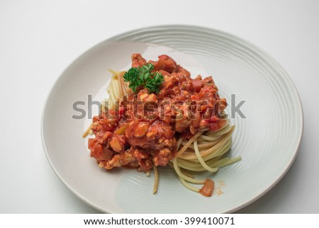 Spaghetti with red sauce in a dish - stock photo