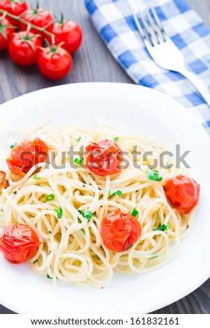 Spaghetti with roasted tomatoes and herbs