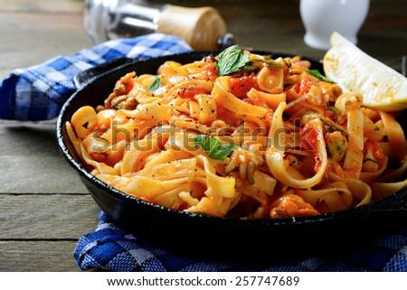 Spaghetti with sauce and seafood, italian food - stock photo