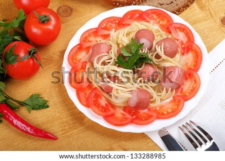 Spaghetti with sausage - stock photo