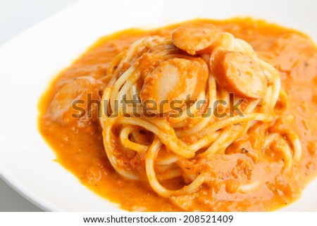 Spaghetti with sausage and tomato cream sauce