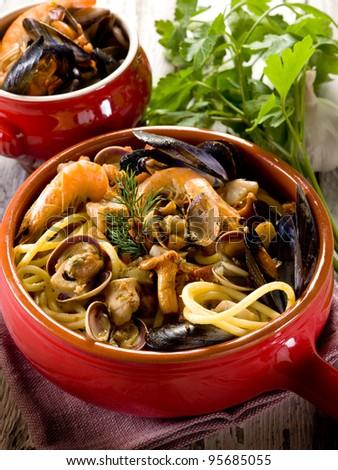 spaghetti with seafood and mushrooms - stock photo