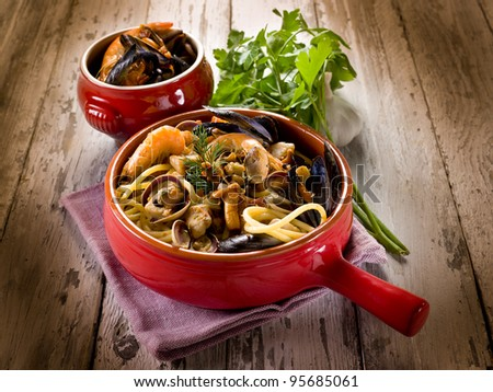 spaghetti with seafood and mushrooms - stock photo