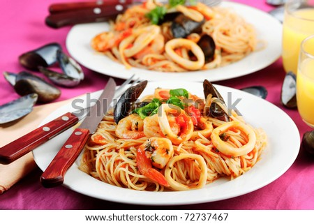 spaghetti with seafood, mussels squid and shrimp - stock photo