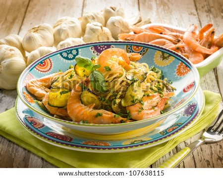 spaghetti with shrimp and zucchinis - stock photo