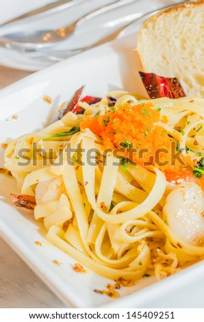 Spaghetti with shrimp&egg shrimp in white dish on the stone table