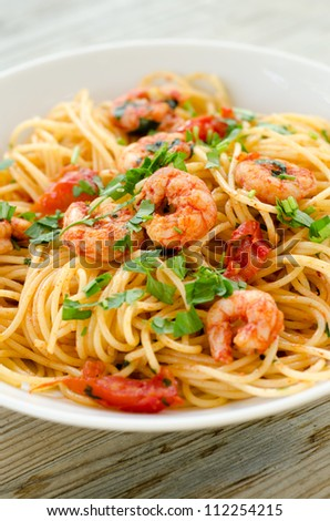 Spaghetti with shrimps,tomato and chopped parsley