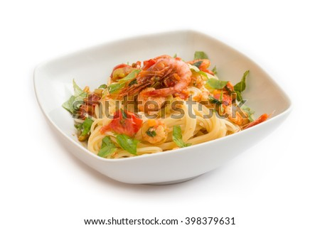 Spaghetti with shrimps, tomato and parsley