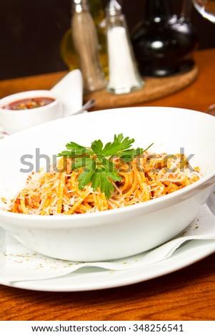 Spaghetti with tomato and basil sauce - stock photo