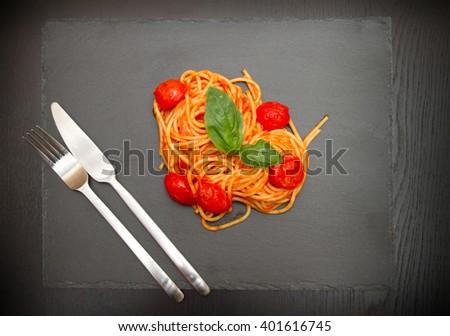 spaghetti with tomato sauce and basil - stock photo