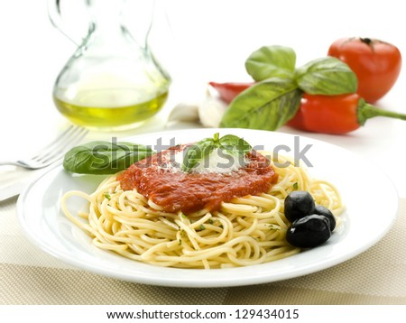 Spaghetti with tomato sauce and basil and olives - stock photo