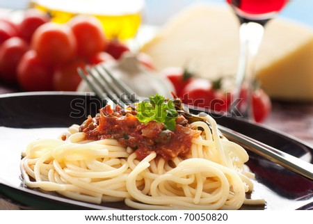Spaghetti with tomato sauce, capers and anchovies. - stock photo