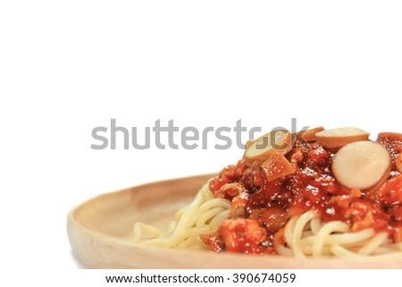 Spaghetti with tomato sauce on white background - stock photo