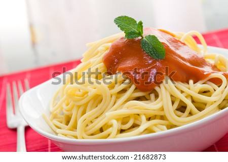 spaghetti with tomato sauce on white bowl and fork - stock photo