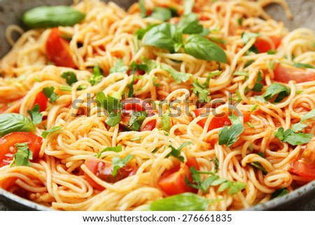 Spaghetti with tomatoes and basil - stock photo