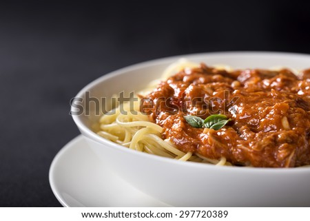 Spaghetti with Tuna sauce over black background with copy space - stock photo