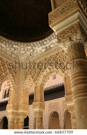 Spain, Andalusia, Granada, Alhambra and Generalifepalace - patio and intricately carved moorish arches in stucco and marble. - stock photo