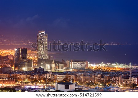Spain, Barcelona city skyline at night by the Mediterranean Sea