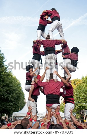 Spain, Barcelona - June 18: Traditional human towers called Castell in Catalonia. The people who build it called Castellers. Castells were declared by UNESCO. Barcelona on June 18, 2011. - stock photo