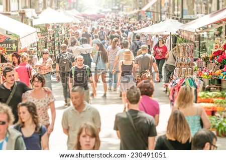 SPAIN, BARCELONA - SEPTEMBER 3: people in La Rambla street. It stretches for 1.2 kilometers. It is popular with both tourists and locals alike. May 15, 2012, Spain, Barcelona, Europe. - stock photo
