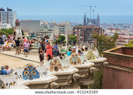 SPAIN, BARCELONA - SEPTEMBER 13: Tourists in Park Guell, Barcelona, Spain on September 13, 2015
