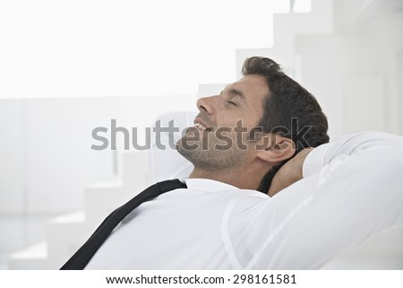 Spain, Businessman relaxing, smiling