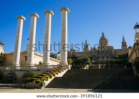 Spain, Catalonia, Barcelona, The Four Columns Puig i Cadafalch, symbol of Catalonia. Each representing the four stripes of the Catalan senyera. In the Background the Royal Palace. - stock photo