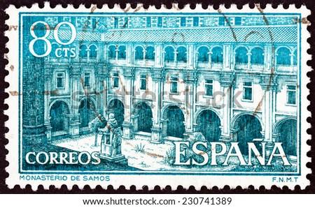 SPAIN - CIRCA 1960: A stamp printed in Spain shows Samos Monastery, circa 1960.  - stock photo