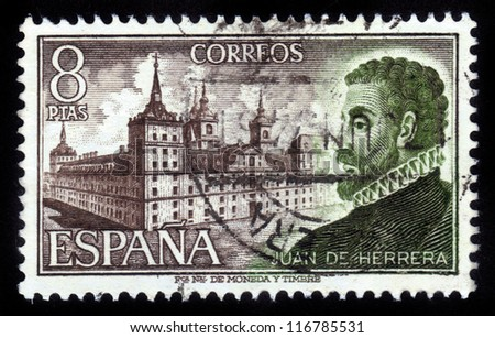 SPAIN - CIRCA 1973: A stamp printed in Spain shows Spanish architect and scholar Juan Bautista de Herrera, against the background of the monastery-palace of Escorial , circa 1973
