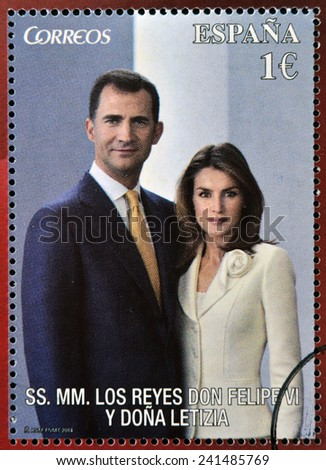 SPAIN - CIRCA 2014: A stamp printed in Spain shows the king of spain, Felipe VI and his wife Queen letizia, circa 2014  - stock photo