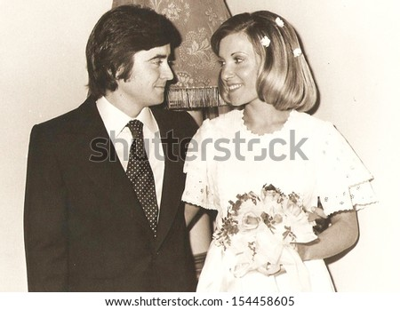 spain, CIRCA  - Groom and bride, official photos - circa 1975  - stock photo
