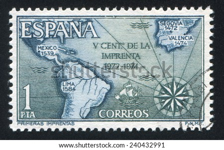 SPAIN - CIRCA 1974: stamp printed by Spain, shows Map of Spain and Americas with Dates of First Printings, circa 1974 - stock photo