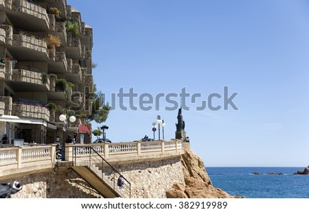 Spain. Costa - Brava. A view of the embankment and hotel  on the rock of Tossa de Mar
