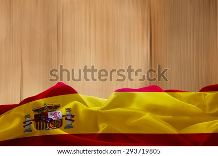Spain flag and wood background