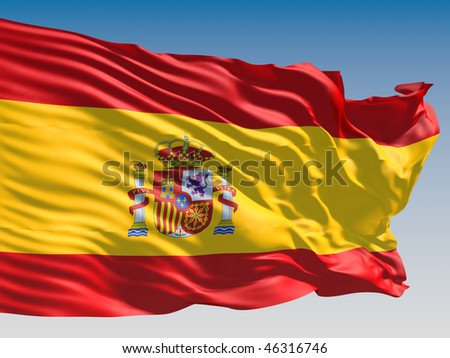 Spain flag flying on clear sky background. - stock photo