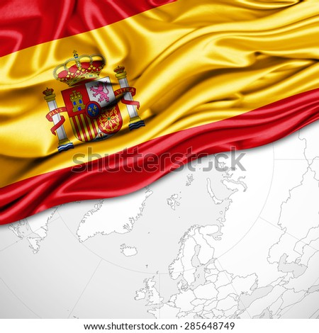 Spain  flag of silk and world map background - stock photo