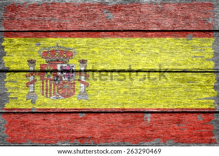 Spain flag on old wood texture background - stock photo