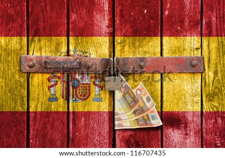 Spain flag on the background of old locked doors - stock photo