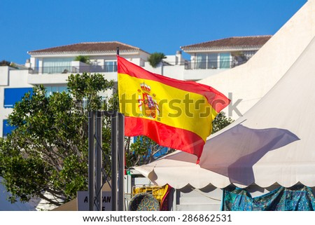 Spain flag waving in the wind - stock photo