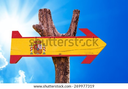 Spain Flag wooden sign with sky background - stock photo