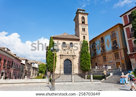 SPAIN, GRANADA - SEPTEMBER 15, 2013: Tourists near old church in Granada. Granada - the city and municipality in Spain, the capital of the province Granada as a part of autonomous community Andalusia - stock photo