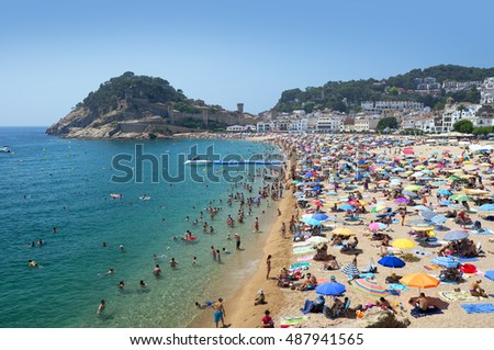 SPAIN - JULY 7, 2015: Tossa Beach, famous destination in Spain is located in Tossa de Mar in Catalonia by the Balearic Sea. Beach is distanced 105 km north of  Barcelona and close to Girona airport.