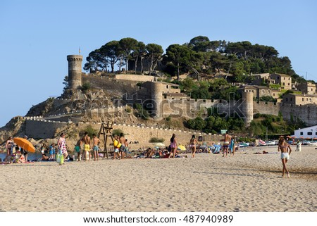 SPAIN - JULY 16, 2015: Tossa Beach is famous destination in Spain, located in Tossa de Mar in Catalonia on the shore of Balearic Sea. Distanced 105 km north of  Barcelona and close to Girona airport.