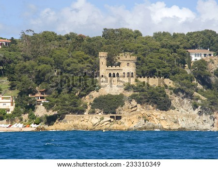 Spain. Lloret de Mar. A view of a fortress from the sea - stock photo
